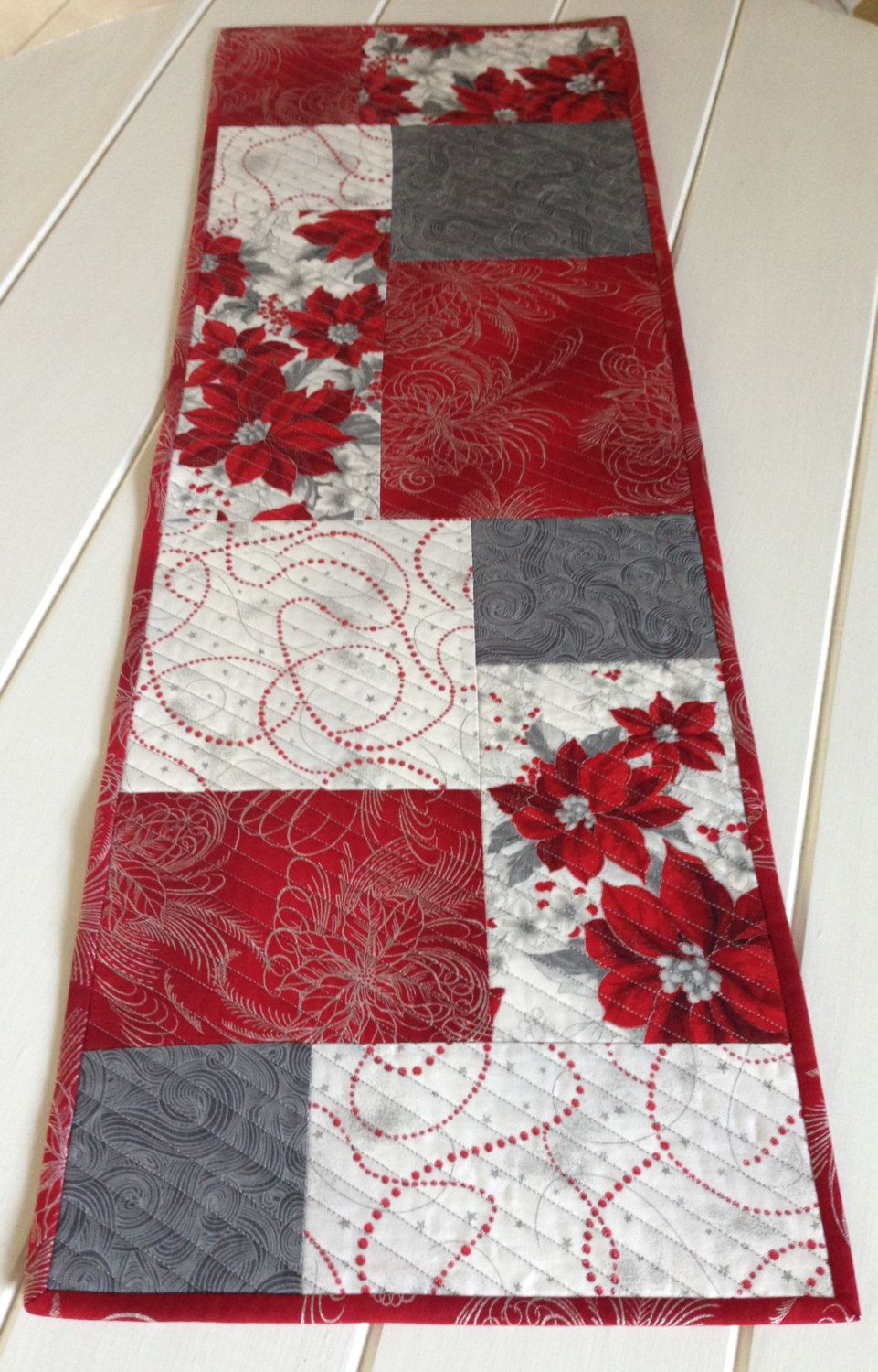Reversible Quilted Christmas Table Runner In Red And Silver Cloth For