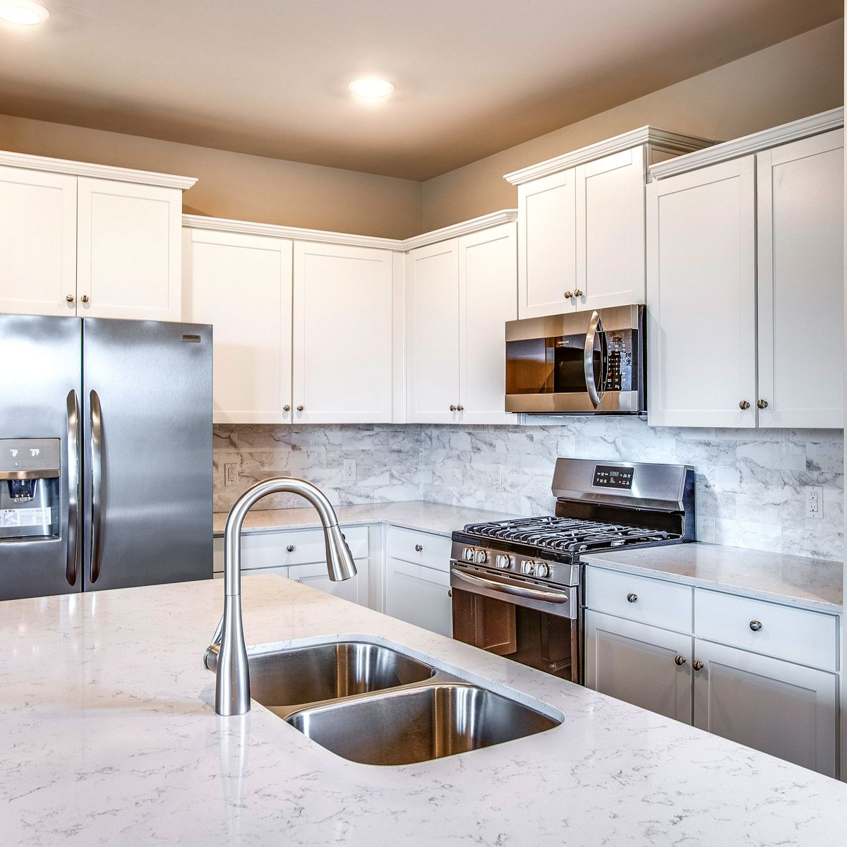 Are You Enchanted By The Quartz Countertops In This Bright White