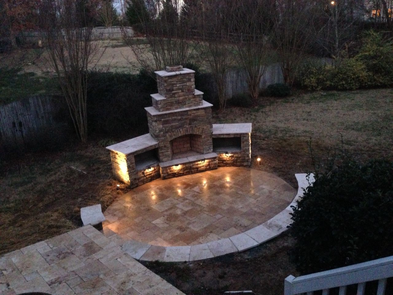 Stack stone outdoor fireplace and sitting walls with travertine stack stone outdoor fireplace and sitting walls with travertine patio and low voltage lighting by workwithnaturefo