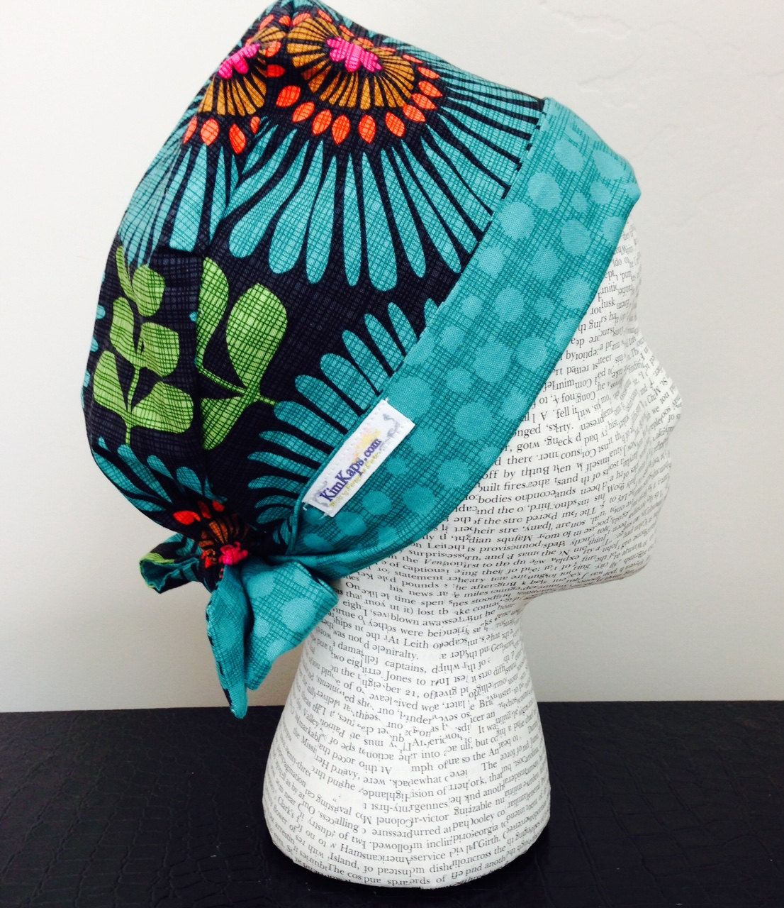 Tie Back Surgical Scrub Cap Featuring Black Fabric With Turquoise Orange Pink Brown