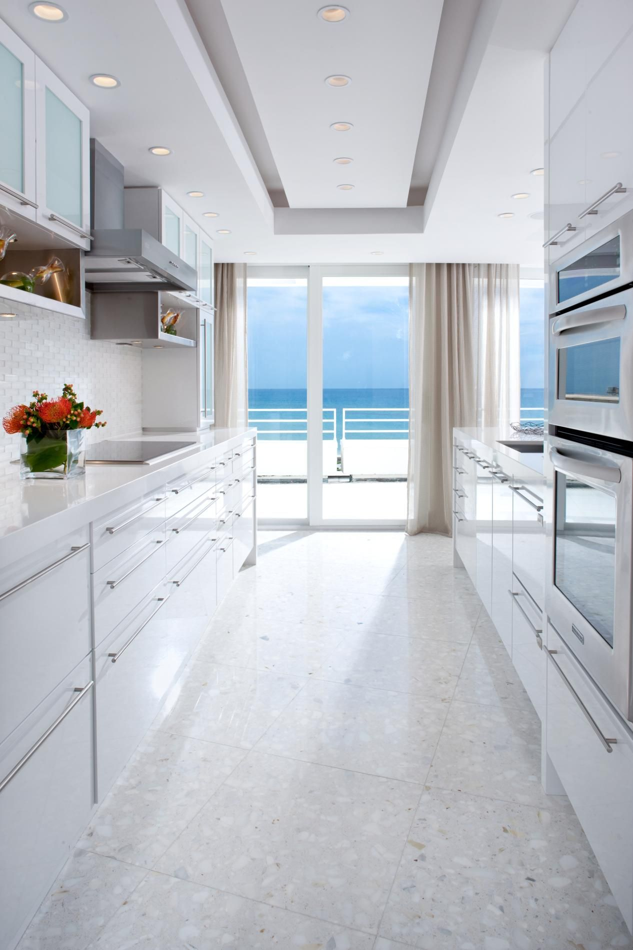 Nice white kitchen design for a long narrow space. with an ... on narrow homes, narrow modern house, narrow bathroom designs, narrow lot floor plans 1600, narrow night stand, narrow house plans, narrow garden designs,