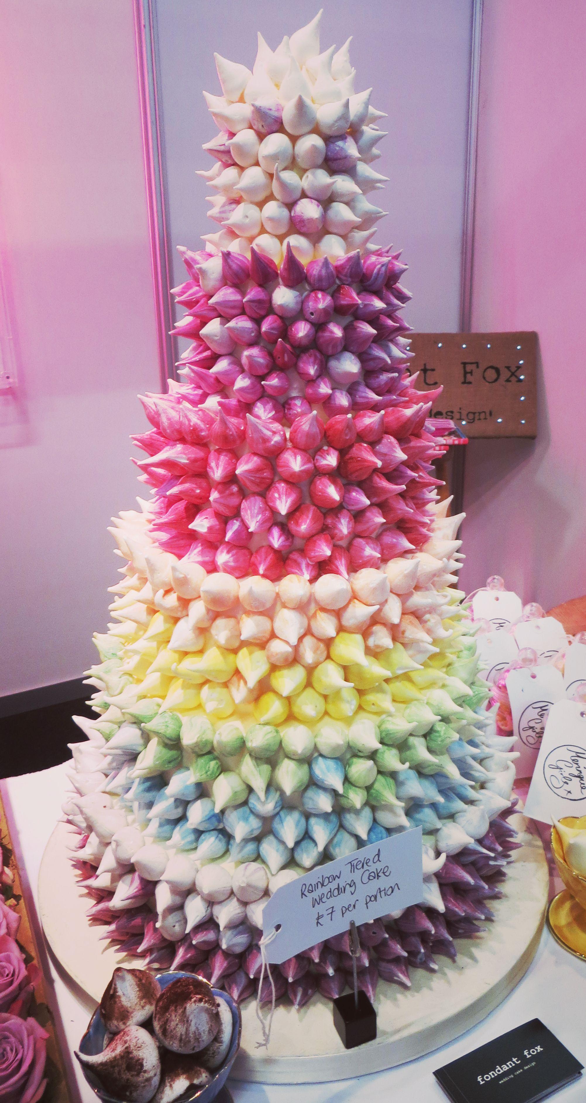 Rainbow coloured meringue 6 tier wedding cake by Fondant Fox Cake