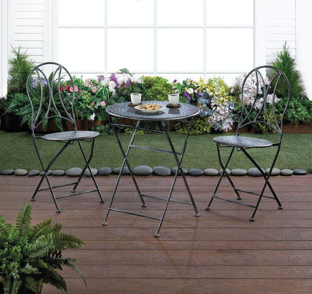 Hammered textured patio set this threepiece patio set takes up a