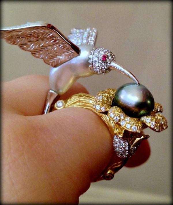 Emiko Pearls' bird ring, a one of a kind piece featuring Keshi pearls and white and yellow diamonds. Via Diamonds in the Library.