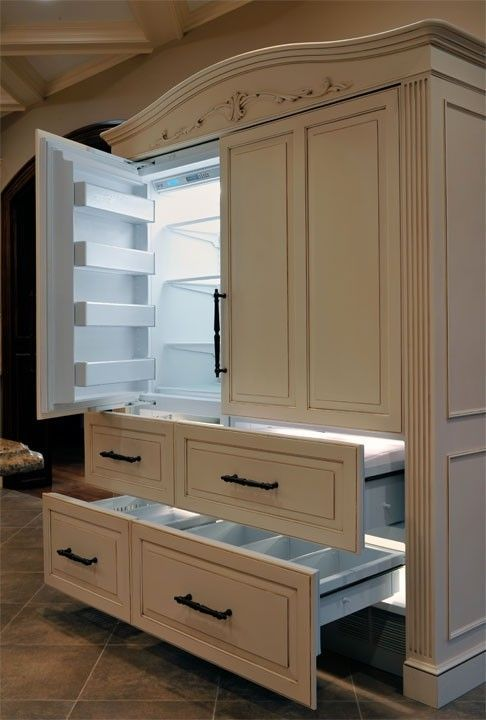 The 700 Series Sub Zero Refrigerator Freezer Is Cloaked With Panels And A Pediment Above To Disguise It As Separate Piece Of Furniture