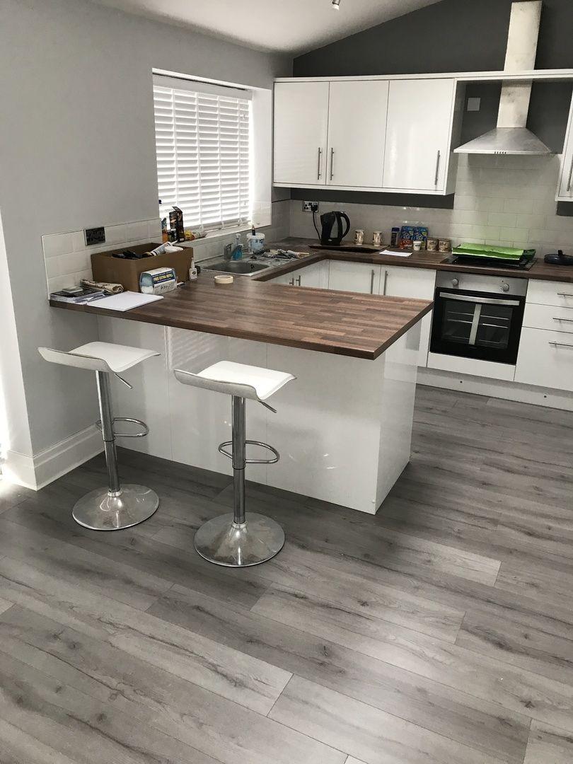 Gorgeous Dark Wood Laminate Flooring White Kitchen Cabinet White Round Dining Table With Black Chair Kitchen Flooring Wood Floor Kitchen Grey Laminate Flooring