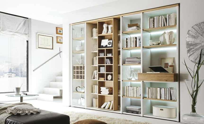 The Ikea Billy Bookshelves Come In Beige And Other Colors And Have Adjustable Shelves That Bookcase With Glass Doors Ikea Living Room Small Living Room Chairs