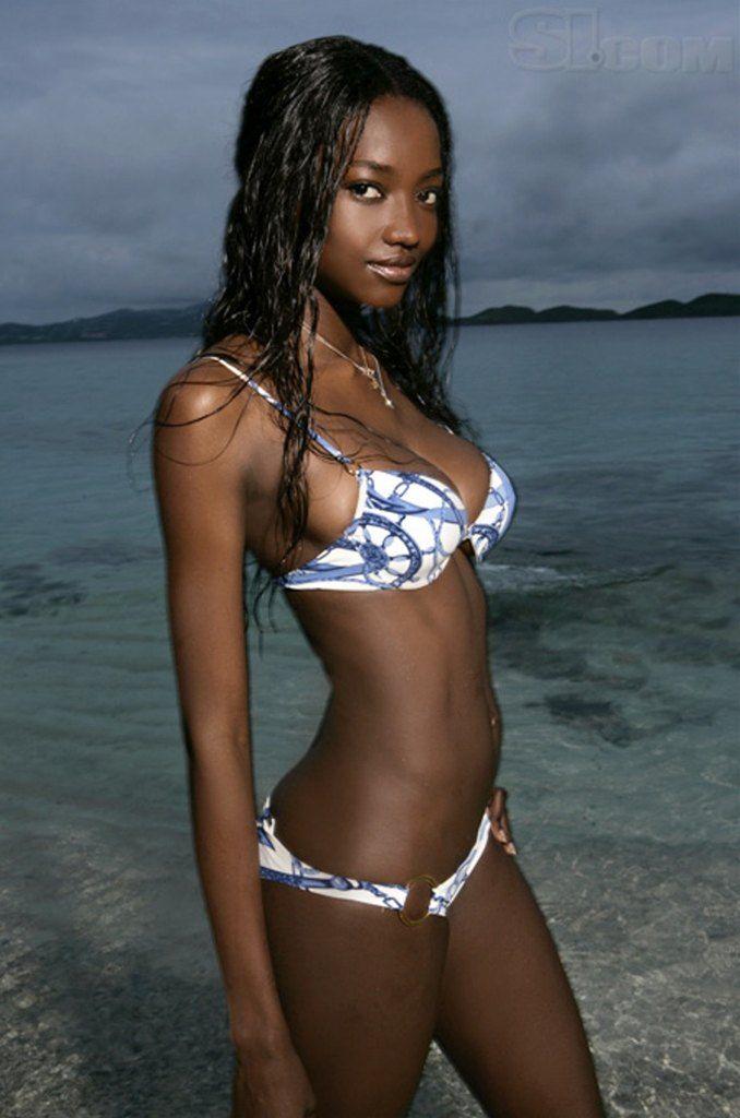 Portrait of beautiful dark skin model girl with bronze make