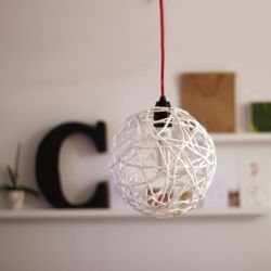 An individual lamp made out of string.
