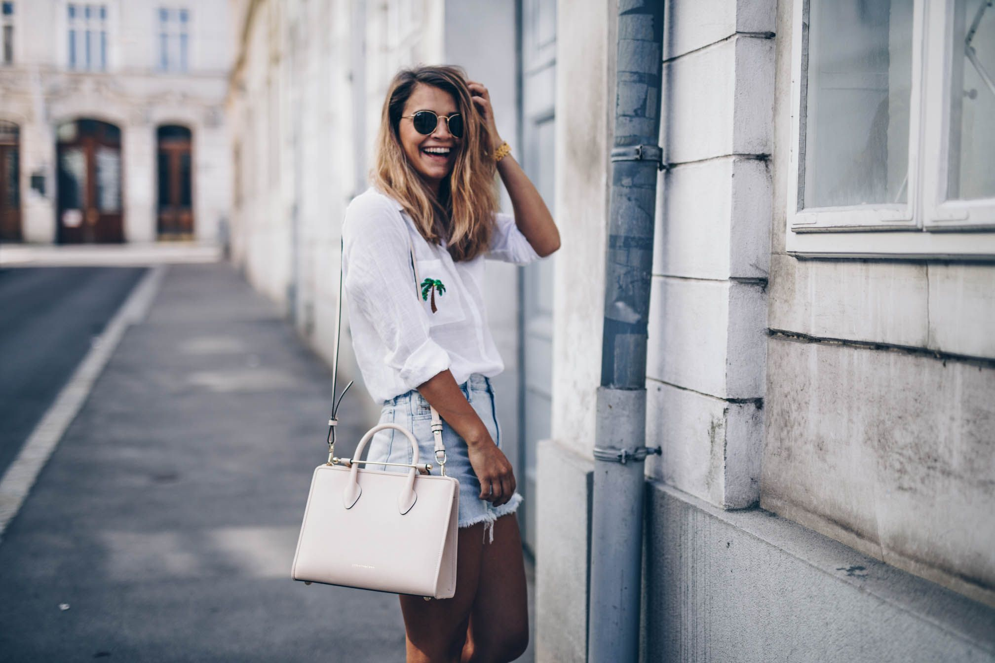 48202a20d8 Nina Radman carries The Strathberry Midi Tote in Nude