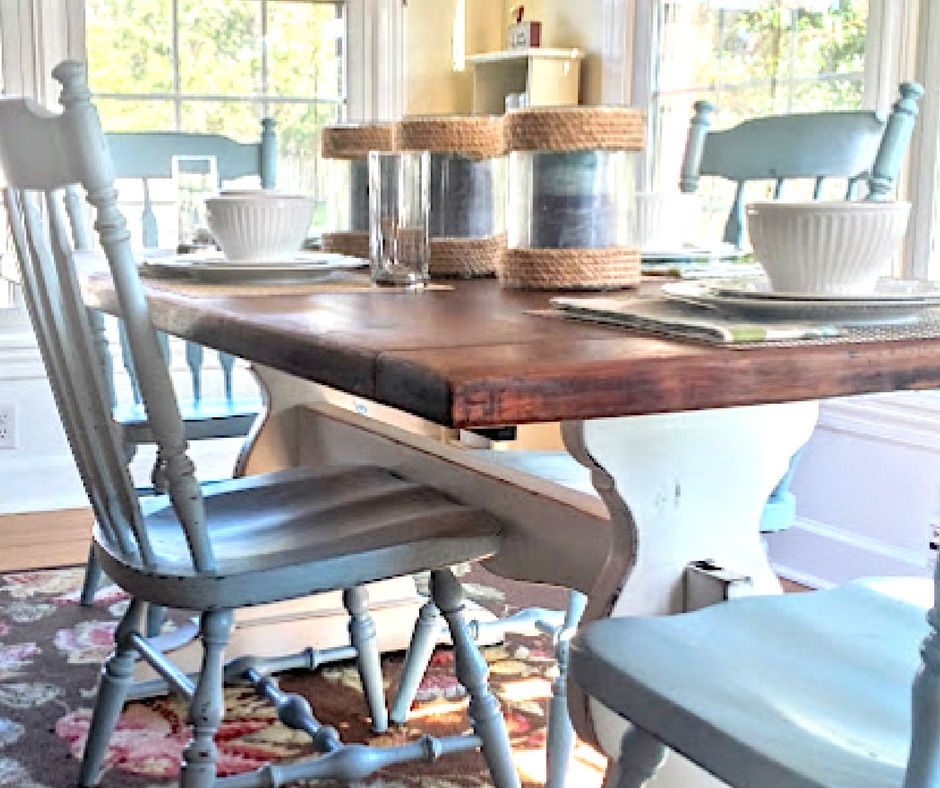 This rustic farmhouse trestle table was given a two tone