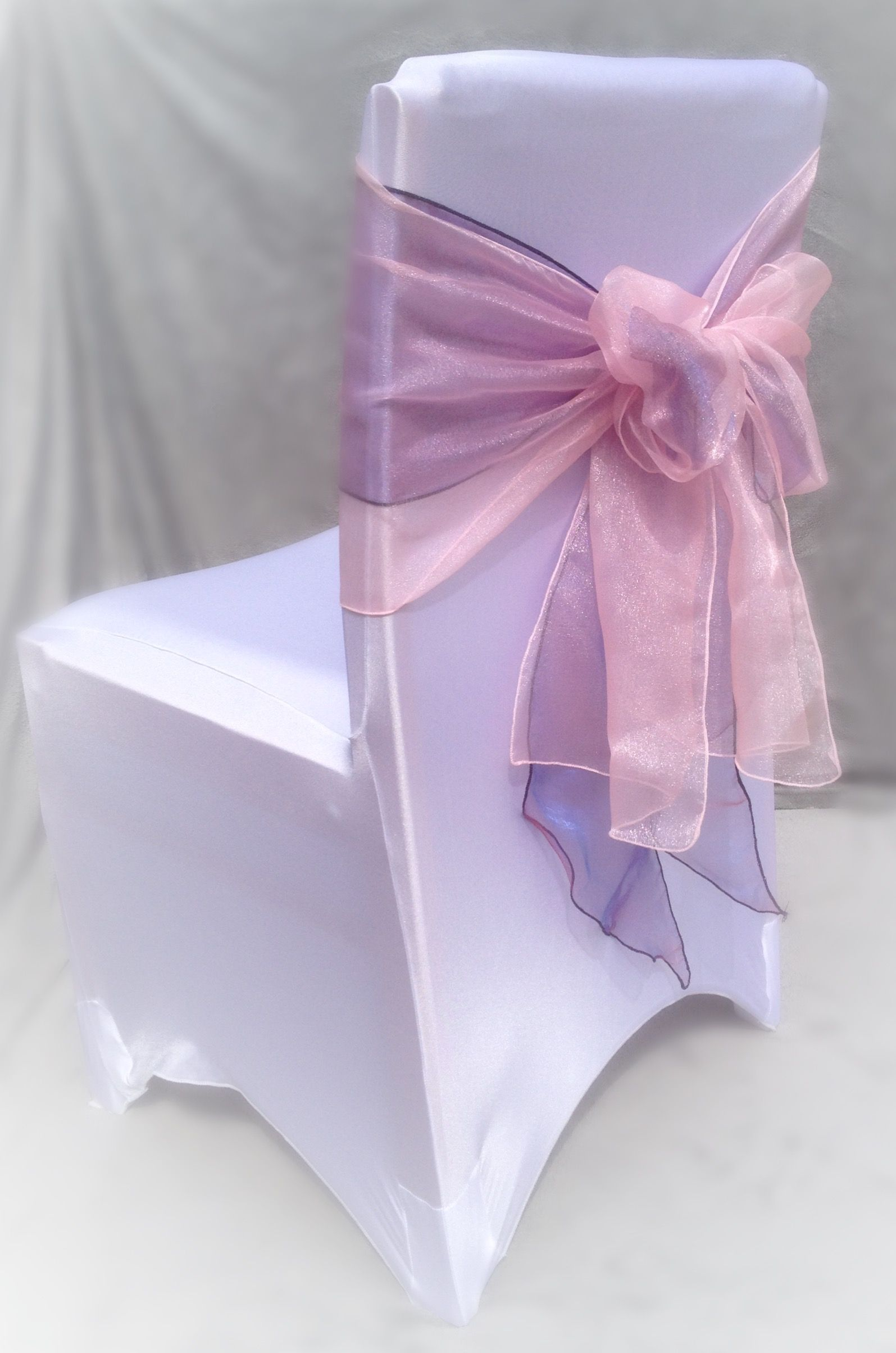White Chair Cover With Pink And Purple Organza Sashes Available To Hire In Swansea Cardiff Neath Brid Chair Covers Wedding White Chair Covers Wedding Hire