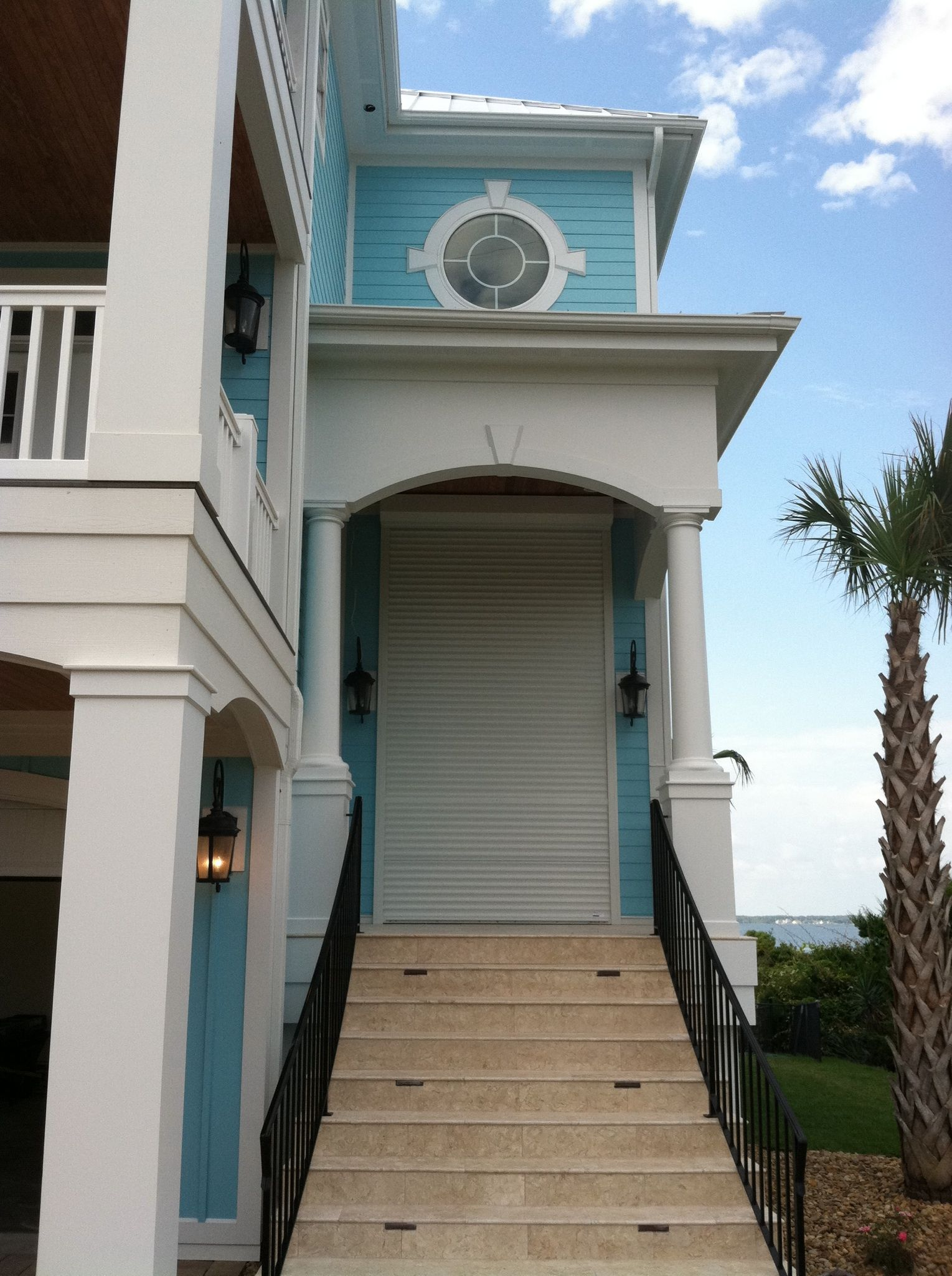 Nc Coastal Home With Security Shutters On Door For