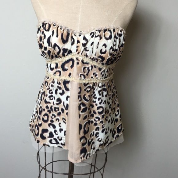 Fabulous Nanette Lepore animal print strapless top Gorgeous silk print with mesh inserts. Back zip mesh lace and tiny beige sequin embellished. 100% silk bodice lining :94% polyester 6% spandex lining: 100% acetate there are buttons on the inside for straps, but the straps are missing! Nanette Lepore Tops