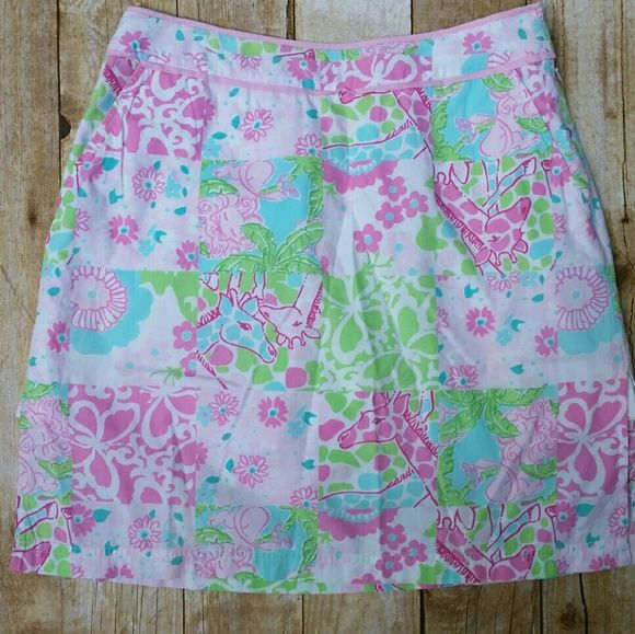 Lilly pulitzer giraffe skirt sz 4 So sweet! Pink and green lilly skirt/skort. Built in shorts underneath! Size 4 in good condition! Lilly Pulitzer Skirts Mini