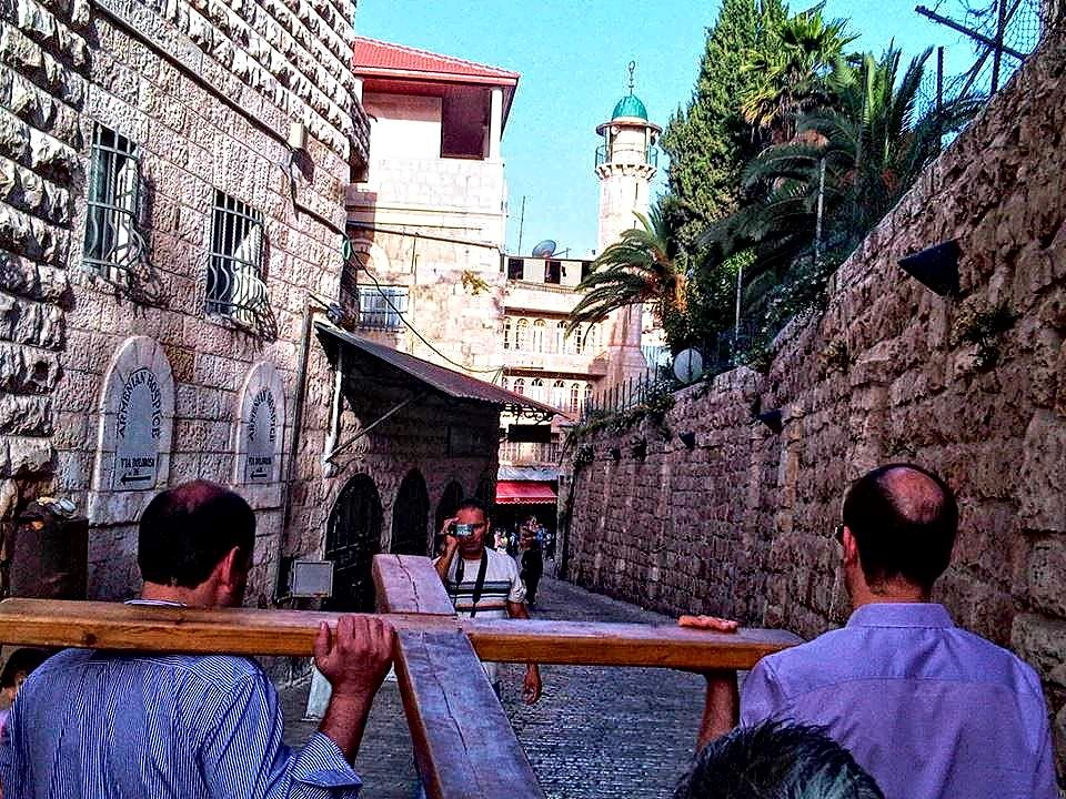 Carrying the cross in the holy land