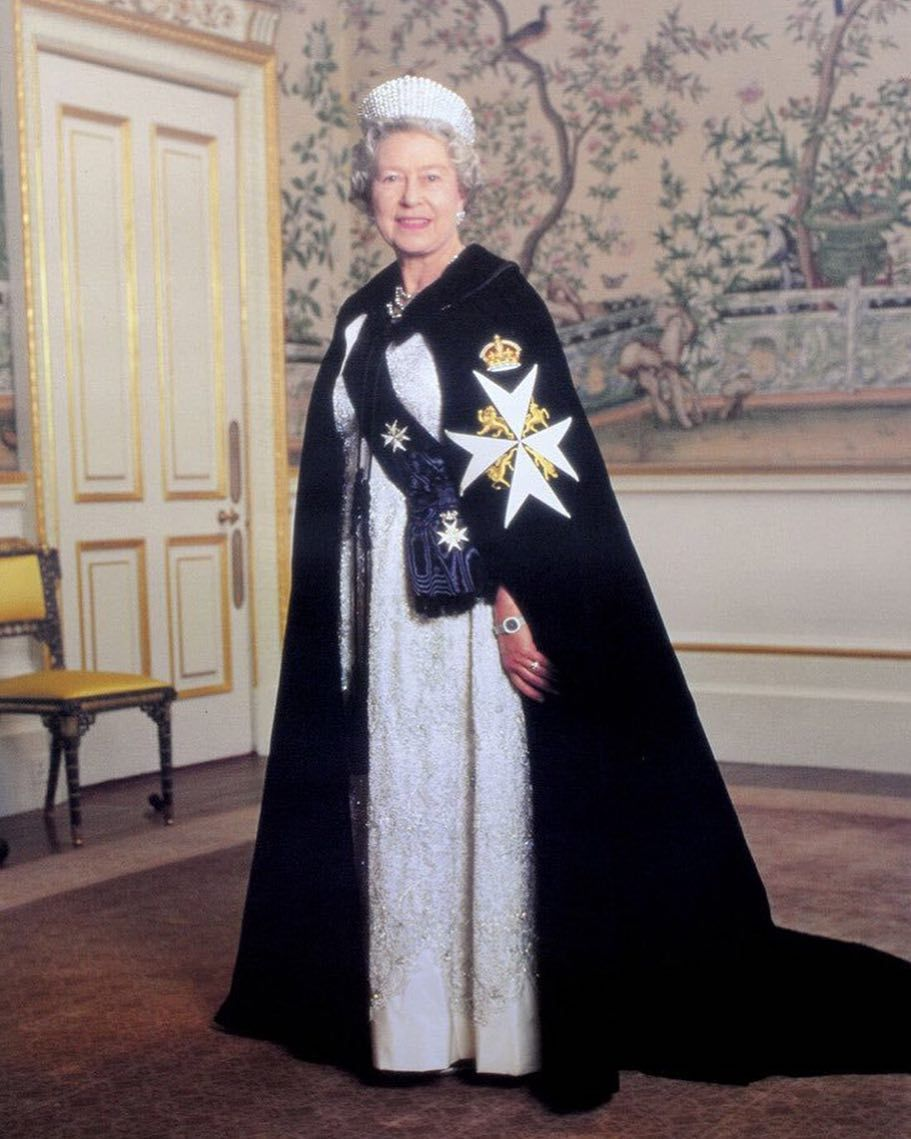 Her Majesty The Queen wearing mantle and full regalia of