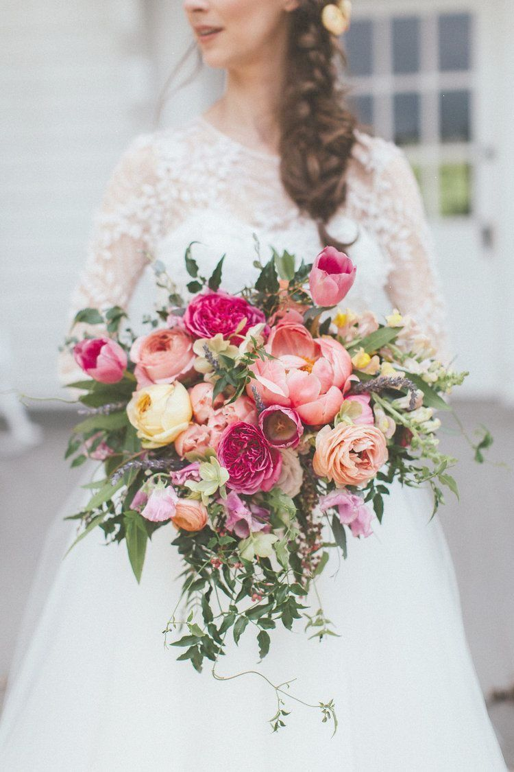 Lush Cascading Bridal Bouquet With Coral Peonies Peach Ranunculus