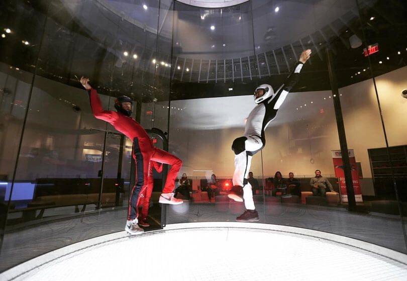 An instructor and markovichmarko flying head up at iFLY
