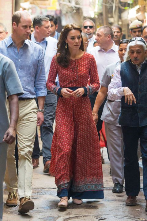 April 12, 2016 — Kate paired a lace-up printed maxi dress by Glamorous with a simple pair of nude flats for her visit to a contact centre run by the charity Salaam Baalak that provides aid to homeless children in New Delhi.