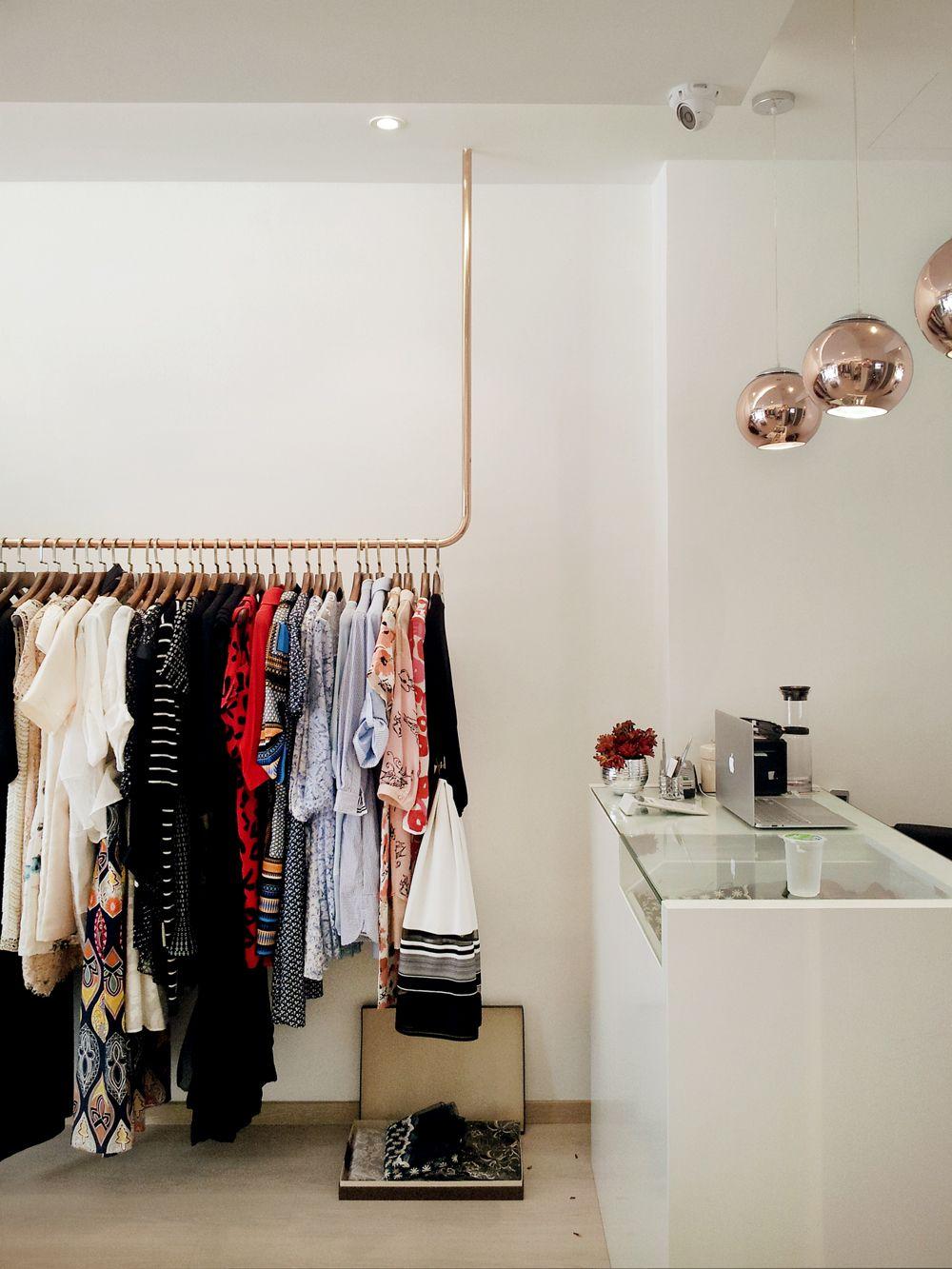 Cashier counter copper cloth hanger retail boutique boutique decor boutique design boutique