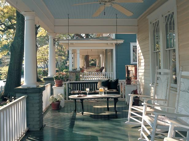 Southern Porch  Wooden rocking chairs and a porch swing make this outdoor space the ideal antebellum retreat.