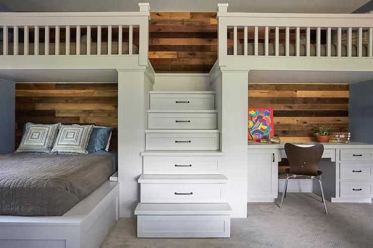 White Wood Stairs Fitted With Storage Drawers Lead To A Twin Loft