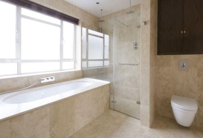 En suite Jacuzzi bath with a separate shower. Warwick Gardens, Kensington, W14