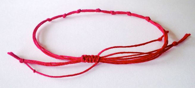 A Simple Red Thread Kavala Or Mauli Hindu Bracelet Jonathon Makes Just Such For Antonia And Ties It On Her Left Wrist As Symbol Of His Love