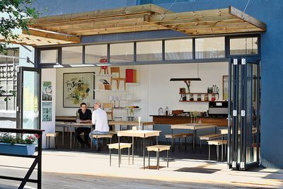 office coffee shop. field office coffee shop exterior with wood overhang and tables e