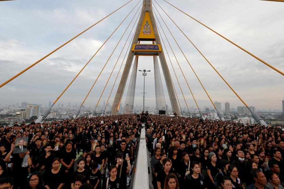 People gather during an event to mark late Thai King Bhumibol Adulyadej's birthday at Bhumibol Bridge over Chao Phraya river in Bangkok, Thailand. REUTERS/Jorge Silva