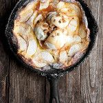 A quick and easy apple dutch baby pancake recipe, with ice cream and caramel sauce. Perfect for dessert or try it for brunch (without the ice cream).