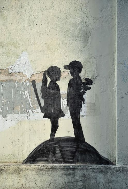 BANKSY He is famous for his satirical street art and