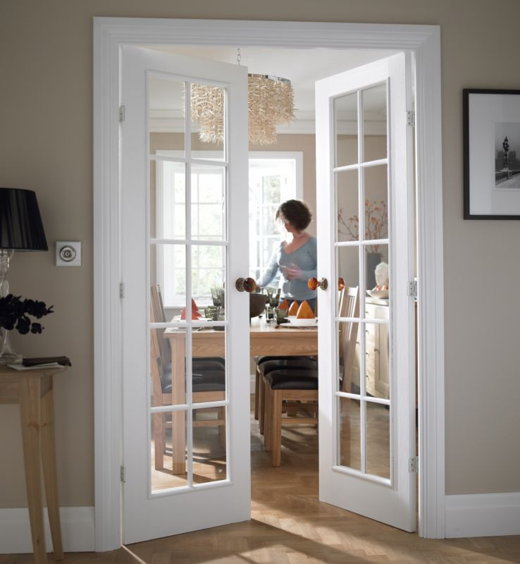 French doors can create a striking entrance to a formal for Dining room ideas with french doors