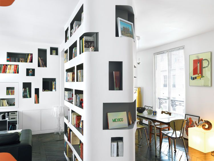 HO Architectes Used Curvy Cutouts In The Spaces Central Column - Clever storage in paris flat