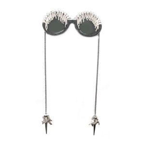 crystal pave'd circle frames with crystal fringe on brow and chain drop arms with spikes attatched