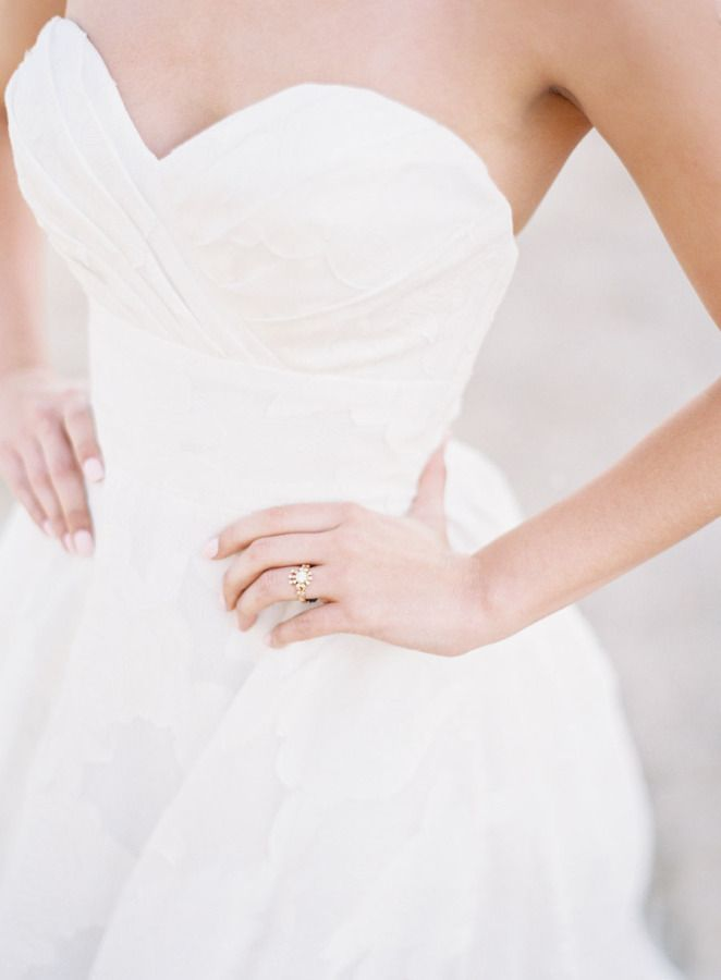 Classic strapless wedding dress: http://www.stylemepretty.com/little-black-book-blog/2016/05/13/engagement-rings-chic-competition/   Photography: Oliver Fly Photography - http://oliverfly.com/