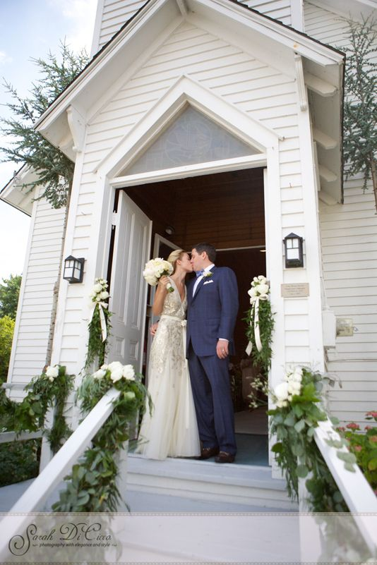 Bride And Groom Kiss On The Steps Of Spray Beach Chapel In Long Island Wearing Dennis Bo