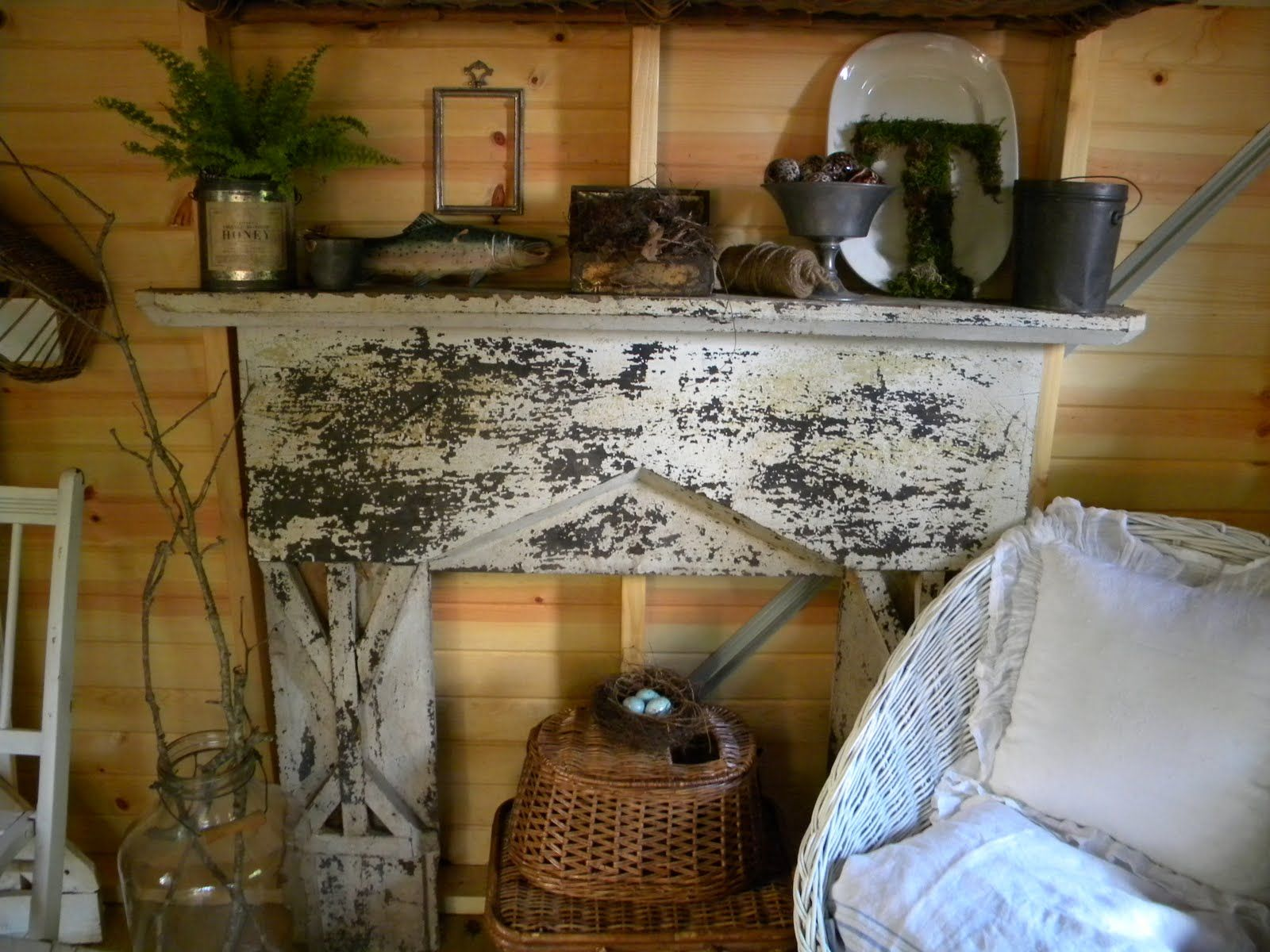 what fun.. this old wood mantle was installed inside a shed. It stores things and provides a little retreat. seen on Three Pixie Lane