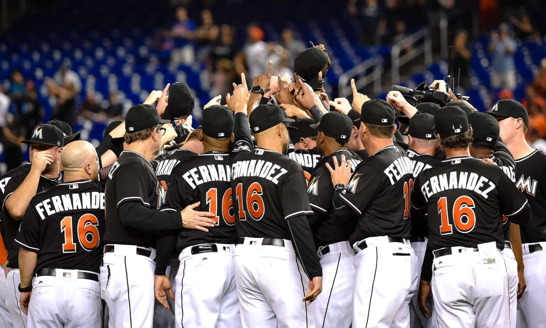 Gone but not Marlins players embrace on the