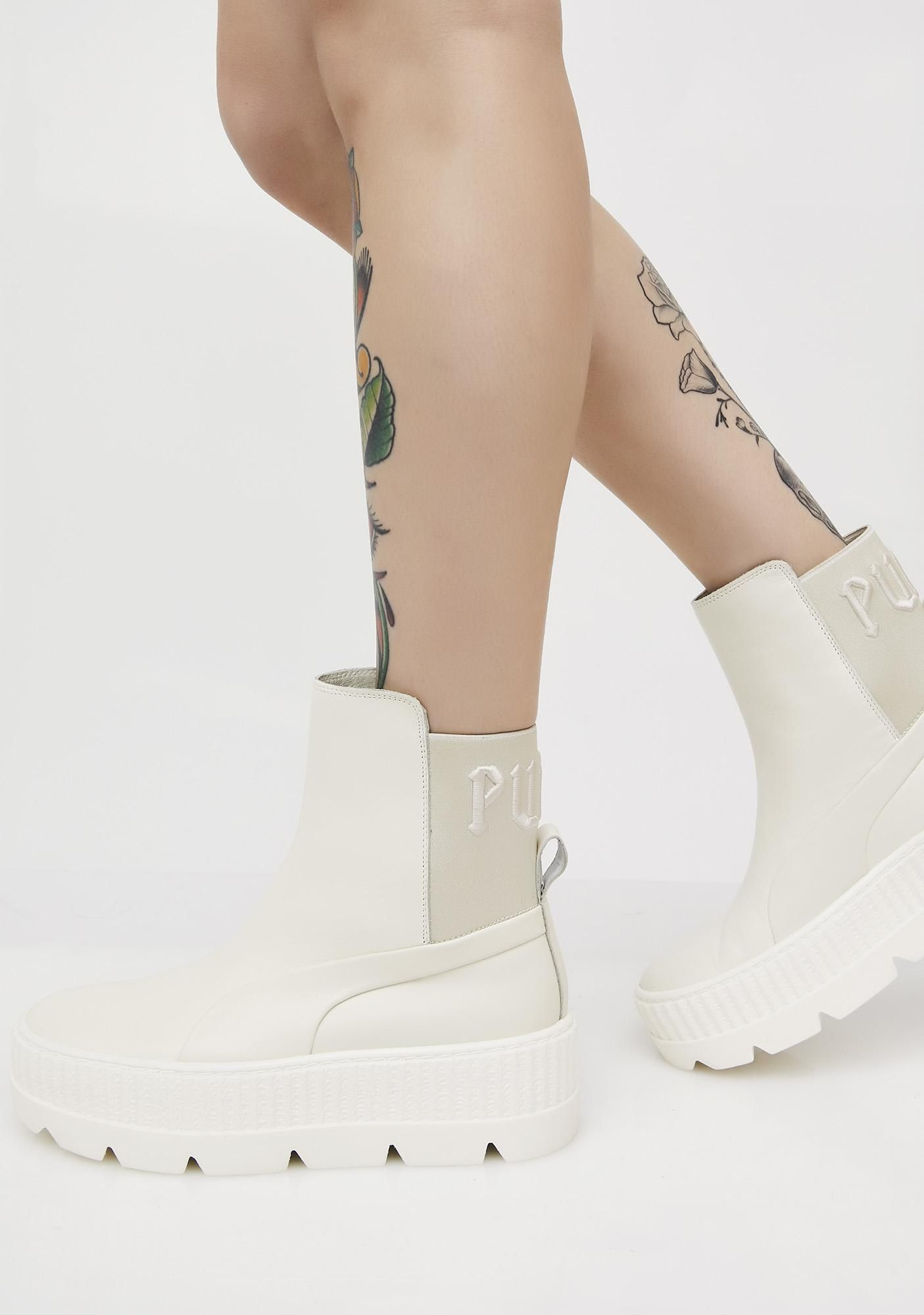 "a3b57bc4021f60 PUMA Vanilla FENTY PUMA By Rihanna Chelsea Sneaker Boots got ya on another  level. These white sneaker boots have thikk soles and ""PUMA"" text on the  back."