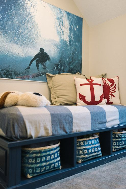 Gorgeous boys bedroom features a PBteen Wave Rider Surf Wall Mural