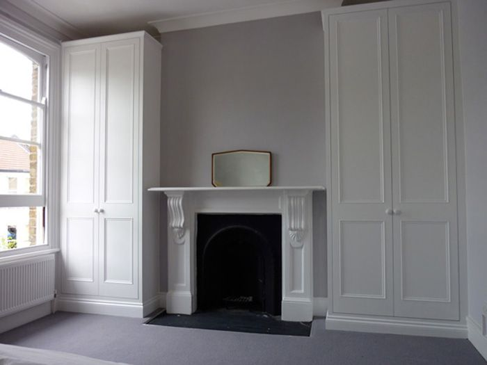 Traditional alcove wardrobes  Made in wood and MDF and hand painted in  eggshell paint  Price for a pair  two  two door  wardrobes Plus VAT  unpainted  a. like floor to ceiling cupboards  would put drawers instead of