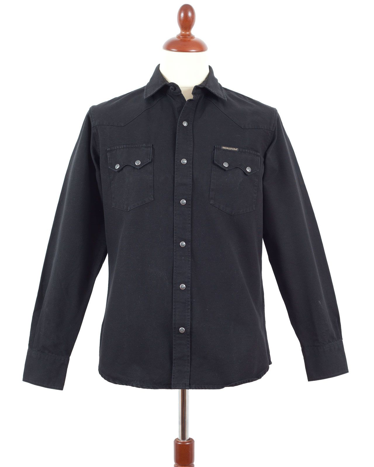 * Indigofera Dollard Shirt, Black. * 100% Cotton canvas fabric. * Two chest pockets. * Snap-buttons. * Made in Portugal.