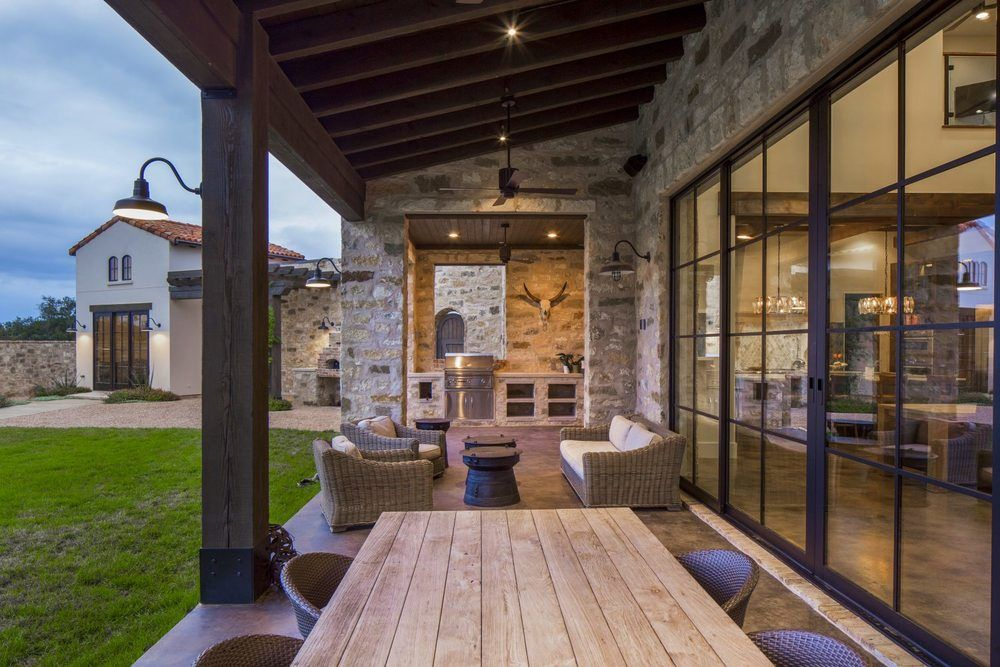 Contemporary Italian Farmhouse Patio. Stone Walls And Roof Tiles. Porch  With Exposed Wood Columns