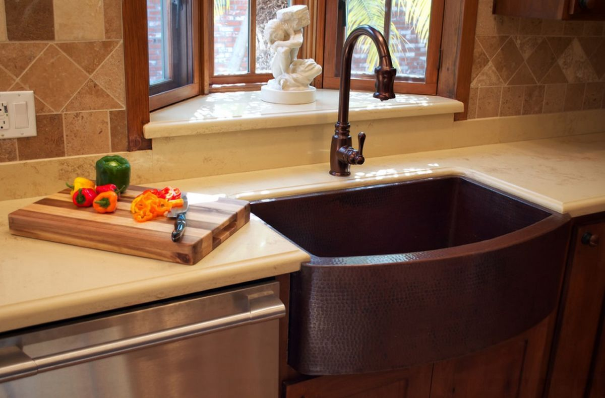 copper-farmhouse-sink-and-matching-faucet - home decorating trends