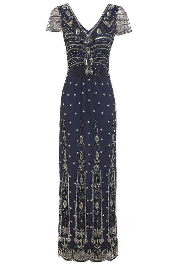 Elegante lange Abend verschönert Kleid mit komplizierten Silber ...