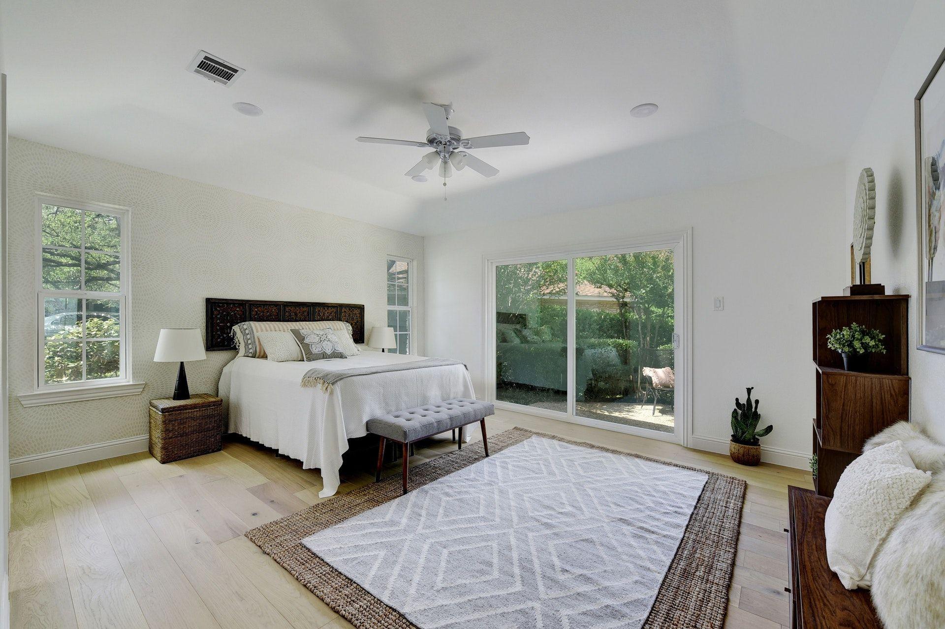 remodeled master bedroom with sliding glass door neutral decor