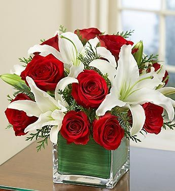 Roses And Lilies Flower Arrangement Christmas Flowers Flower Arrangements Flowers
