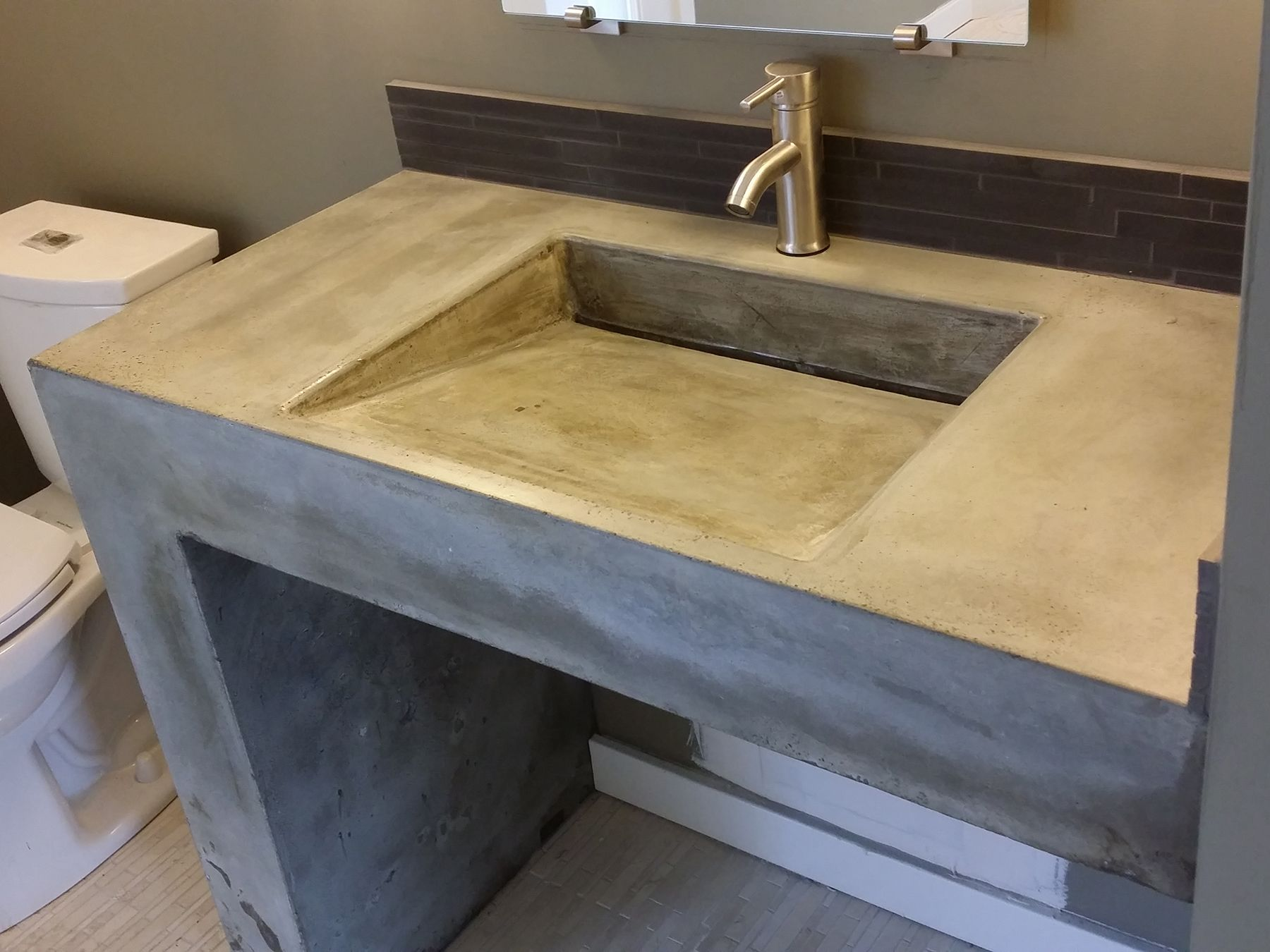 concrete ramp sink with waterfall leg
